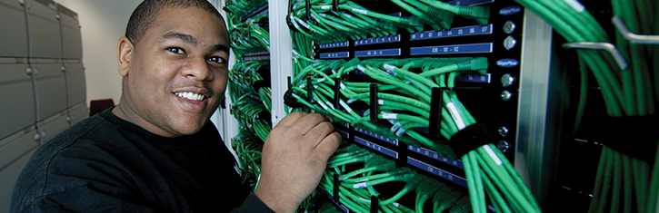 student at server rack